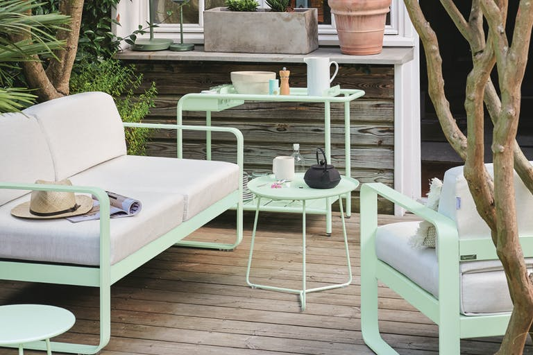 Bellevie outdoor sofa and Luxembourg bar trolley from Fermob in Ice Mint