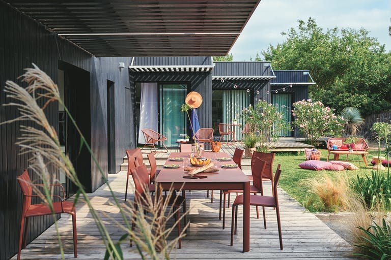 Ribambelle extending outdoor table with Cadiz dining chairs in Red Ochre