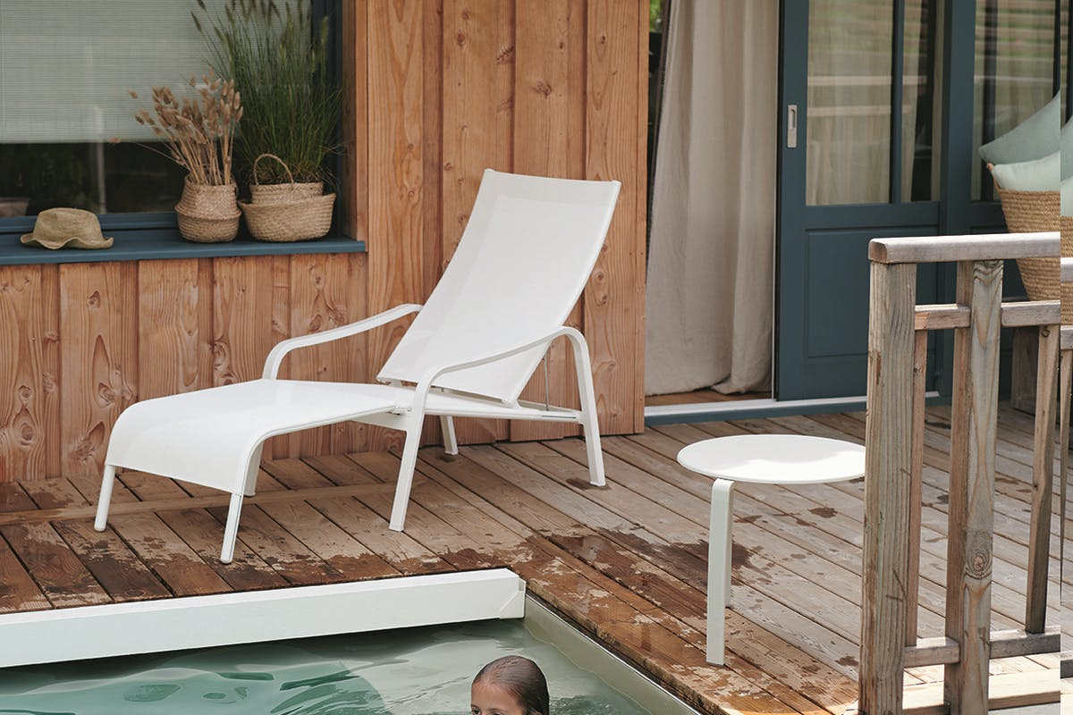 Fermob Alize Low Armchair by swimming pool