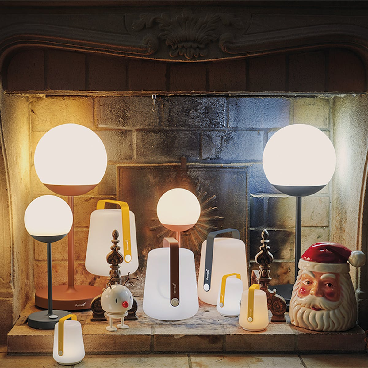 Fermob Balad and Mooon! lamps in Christmas fireplace