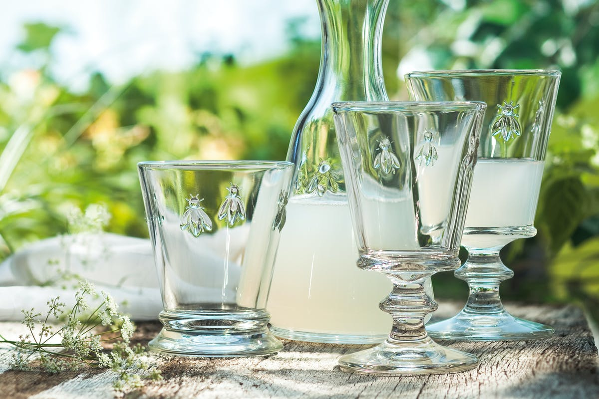 La Rochere Bee collection of glassware on wooden table