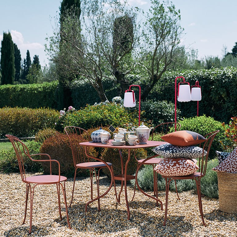 Fermob Opera+ Carronde Table and Chairs in garden