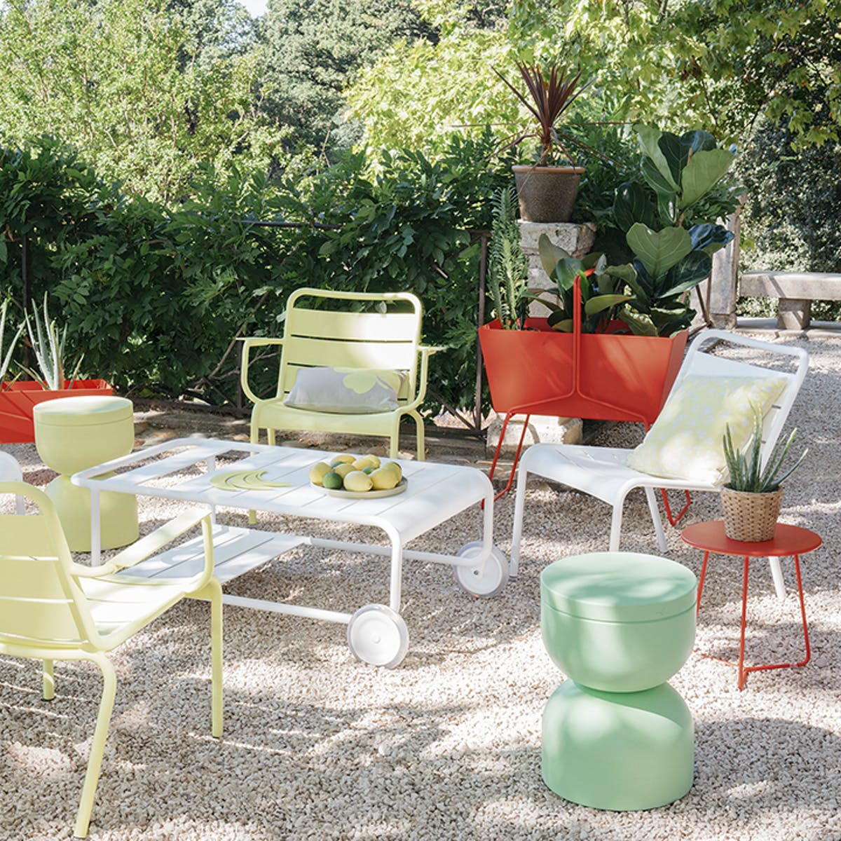 Luxembourg lounge armchairs in pebble courtyard