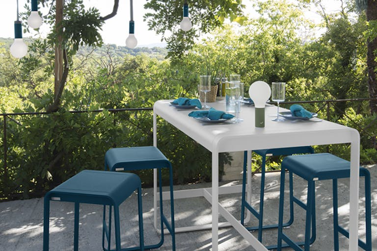 Fermob Belleive high bar table and stools on balcony