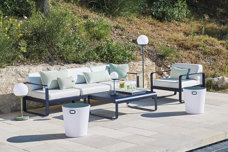 Three seater outdoor sofa with coffee table poolside
