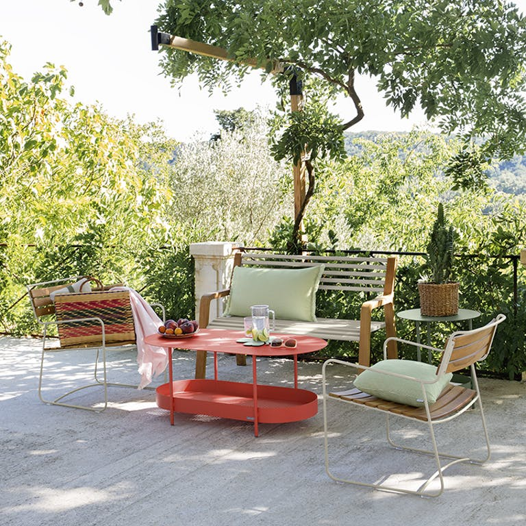 Garden bench and casual chairs on an outdoor terrace