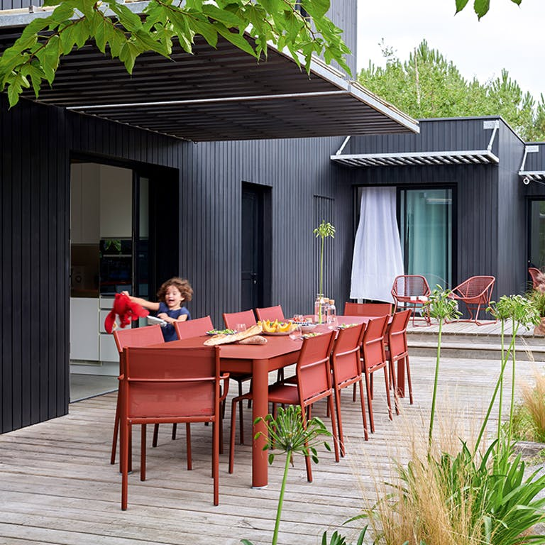 Fermob Outdoor Dining seating for 8 in Red Ochre colour