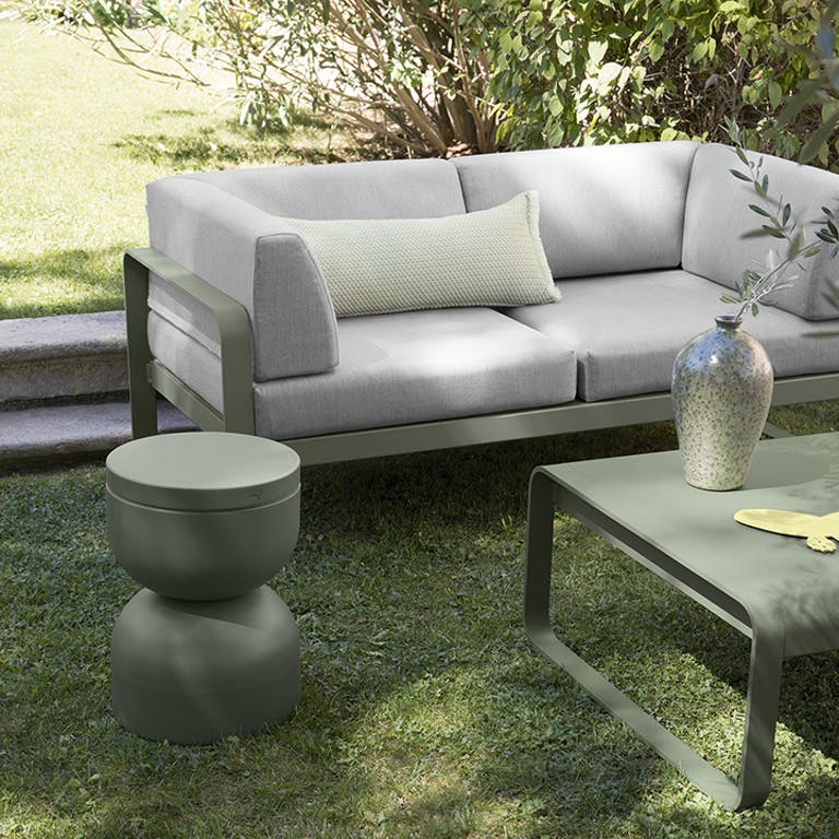Fermob Bellevie Club 2 seater sofa in garden with low table