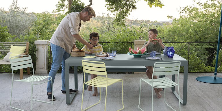 Outdoor Dining Table with chairs and family gathered