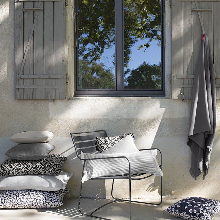 Outdoor cushions in dark tones from Fermob