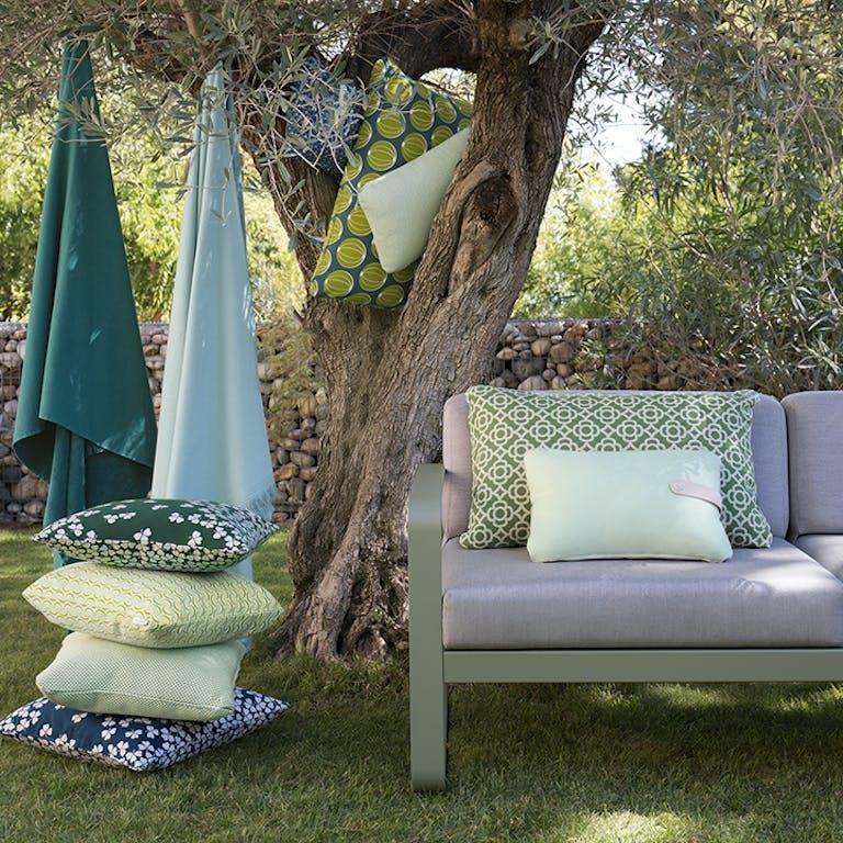 Fermob outdoor cushions in a garden