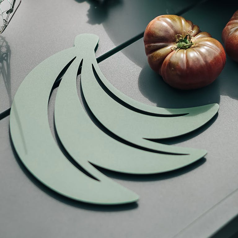 Fermob Bananes trivet on outdoor table